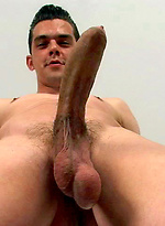 Simon plays with his cock